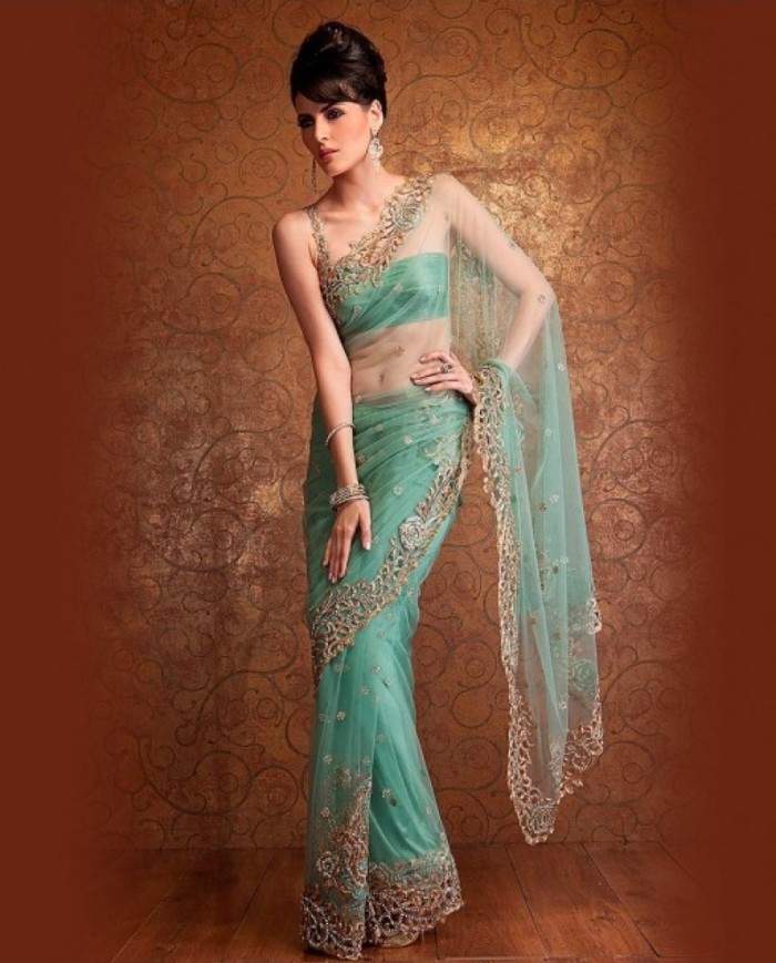 pistachio-green-net-saree-covered-with-floral-bootis-in-stone-work-and-edged-with-a-richly-embellished-gold-cut-work-border-very-understated-and-very-sexy-800x1100
