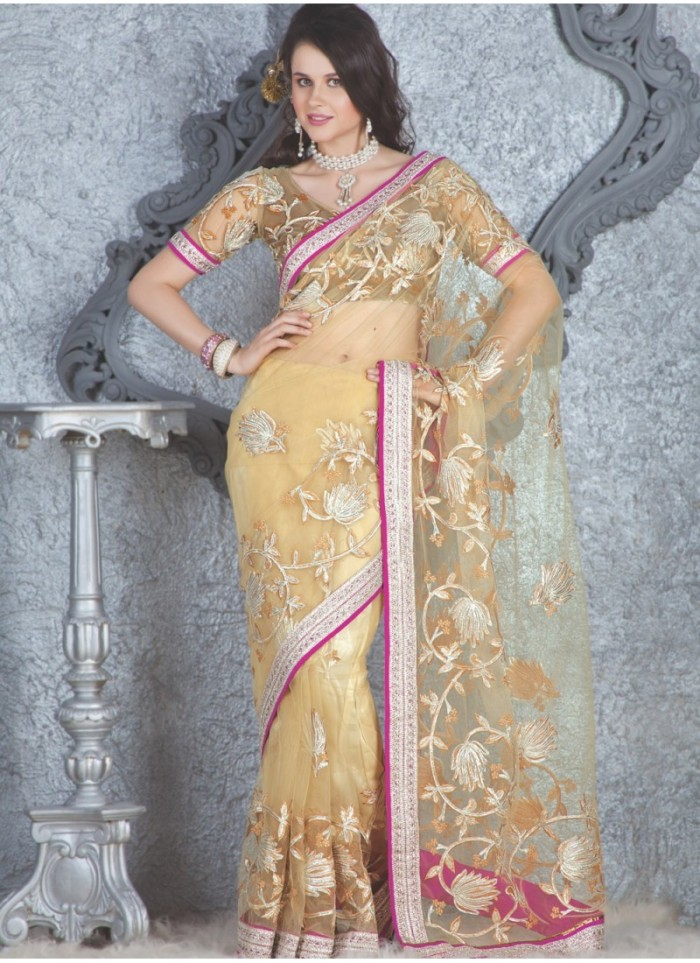 yellow-net-saree-with-a-tint-of-pink-provides-feminine-look-to-the-saree-800x1100